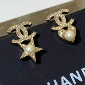 Chanel heart N star studs